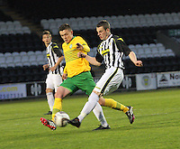 Adam Brown challenged by Connor McManus in the St Mirren v Celtic Scottish Professional Football League Under 20 match played at St Mirren Park, Paisley on 30.4.14.