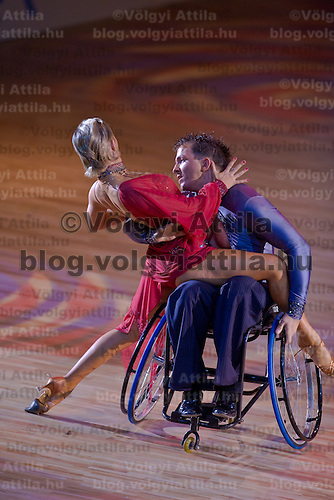 Maxim Sedakov in wheelchair and Svetlana Kukushkina from Russia perform their exhibition dance during the World Latin-american Championships held in Maribor, Slovenia