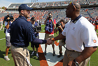 Penn State head coach Bill O'Brien, left, greets Virginia head coach Mike London during an NCAA college football game in Charlottesville, Va. Virginia defeated Penn State 17-16.