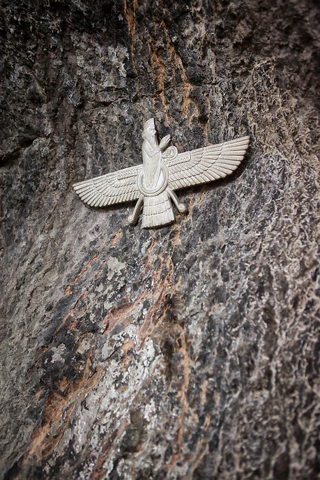 A Zoroastrian emblem at the rock face of Pir-e-Sabz fire temple at Chak Chak, 70 km from Yazd. This place is Iran's most important Zoroastrian pilgrimage centre.