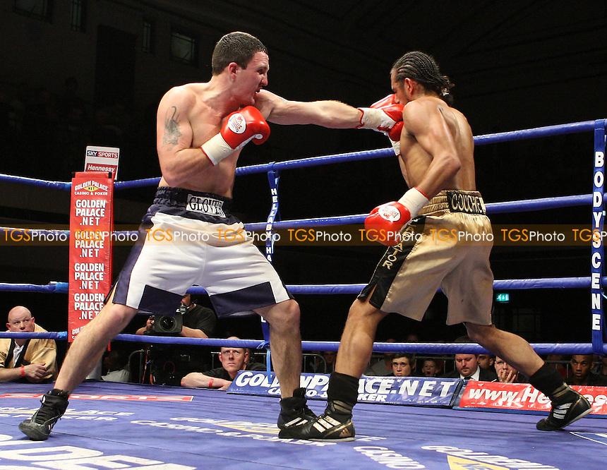 Gareth Couch (High Wycombe, gold shorts) defeats Tom Glover (Colchester, white shorts) in a Lightweight contest at York Hall, Bethnal Green, promoted by Hennessy Sports - 04/04/08 - MANDATORY CREDIT: Gavin Ellis/TGSPHOTO - Self billing applies where appropriate - Tel: 0845 094 6026