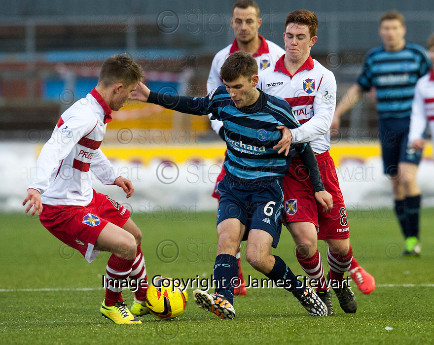 Forfar's Scott Smith tries to get past Stirling's Angus Beith and Craig Comrie.