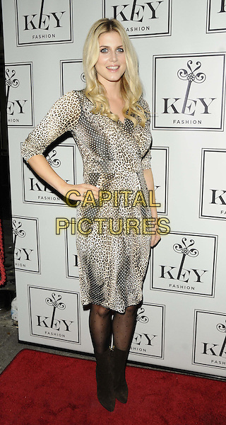 Ashley James<br /> The KEY Fashion new online fashion boutique launch party, Vanilla, London, England.<br /> September 25th, 2013<br /> full length white brown beige leopard print dress hand on hip<br /> CAP/CAN<br /> &copy;Can Nguyen/Capital Pictures