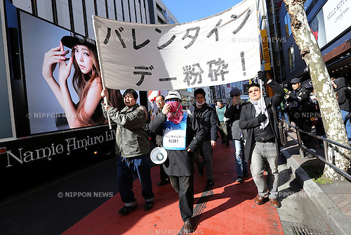 "Demonstrators take part in ""Smash Valentine's Day"" protest as an advertisement truck of Japanese pop star Namie Amuro drives past through the streets of Shibuya district in Tokyo, Japan on February 14, 2015. The group called Kakuhidou, meaning  ""Revolutionary alliance of men whom women find unattractive"" protested that Valentine's Day  is only about marketing and making money by chocolate companies.  (Photo by Yuriko Nakao/AFLO)"