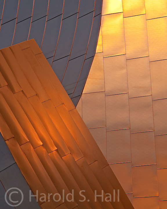The sunrise casts a golden light on the Pritzker Pavilion in Millennium Park Chicago.