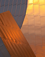 The sunrise casts a golden light on the Pritzker Pavilion in Millennium Park Chicago.
