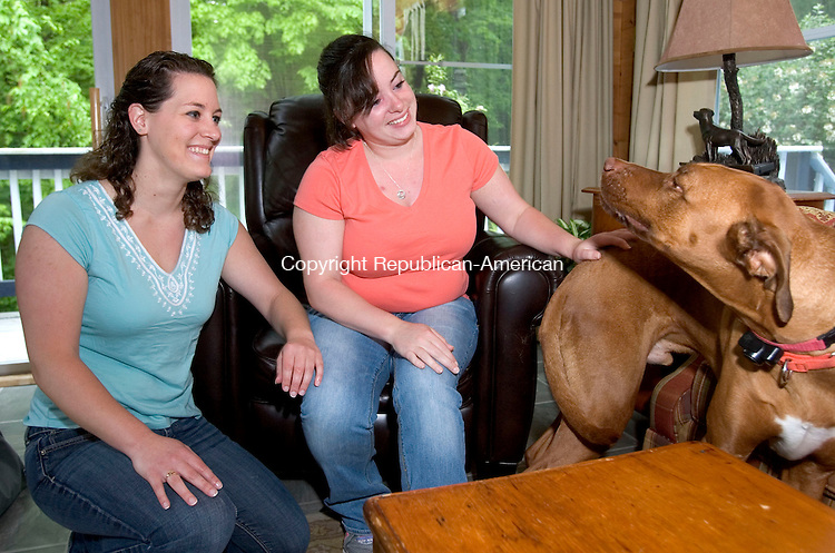 MIDDLEBURY CT. 22 May 2014-052214SV04-From left, Victoria &quot;Tori&quot; Flormann and her sister Alexandria Flormann play with their dog &ldquo;Remi&rdquo; at their home in Prospect Thursday. <br /> Steven Valenti Republican-American