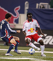 New York Red Bulls forward (30) Francis Doe is marked by New England Revolution defender (6) Jay Heaps. The New York Red Bulls and the New England Revolution played to a 0-0 tie during first leg of the MLS Eastern Conference Semifinal Series at Giants Stadium in East Rutherford, NJ, on October 27, 2007.
