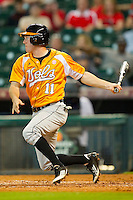 Zach Luther #11 of the Tennessee Volunteers follows through on his swing against the Houston Cougars at Minute Maid Park on March 2, 2012 in Houston, Texas.  The Cougars defeated the Volunteers 7-4.  Brian Westerholt / Four Seam Images