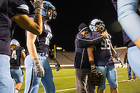 Arkansas Democrat-Gazette/MELISSA SUE GERRITS - 12/05/15 -  Har-Ber's assistant coach Mark Taylor comforts MVP David Vowell after their loss during their 7A Championship game against Fayetteville December 5, 2015 at War Memorial Stadium in Little Rock.