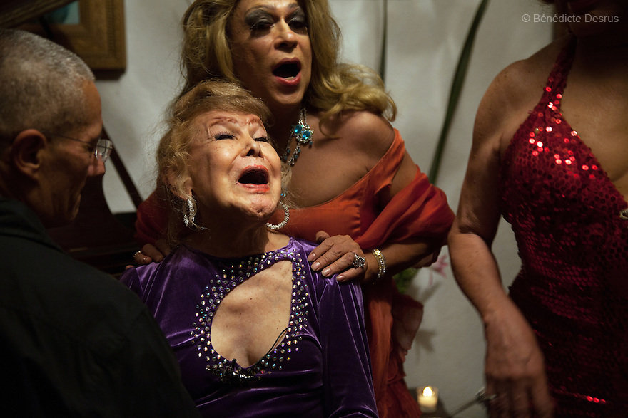 """July 13, 2013 - Mexico City, Mexico - Samantha celebrates her81st birthday with close friends in Mexico City.Samantha Flores is an 81-year-old transgender woman from Veracruz, Mexico. She is a prominent social activist for LGBTQI rights and is the founder of the non-profit organization """"Laetus Vitae"""", a day shelter for elderly gay people in Mexico City. Senior citizens in general are many times prone to neglect and abandonment by their families, leaving them all but invisible. Their plight can be even worse if they are homosexual. Photo credit: Bénédicte Desrus"""
