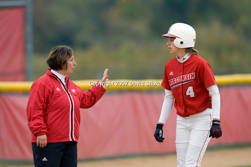 MADISON, WI - OCTOBER 13: Coach Chandelle Schulte of the Wisconsin Badgers talks to Jennifer Krueger #4 during the Red/White scrimmage at the Goodman Softball Complex on October 13, 2007 in Madison, Wisconsin. (Photo by David Stluka).