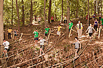 June 1, 2013. Huntersville, North Carolina<br />  In the forest part of the track, runners had to navigate a low ropes course.<br />  A North Carolina chapter of The Warrior Dash, which consists of a 5k run/walk broken up by several obstacles, was held over the weekend with thousands turning out to test their abilities in a race against the clock and each other. Participants in all age groups were sent out in heats over the course of the entire day.