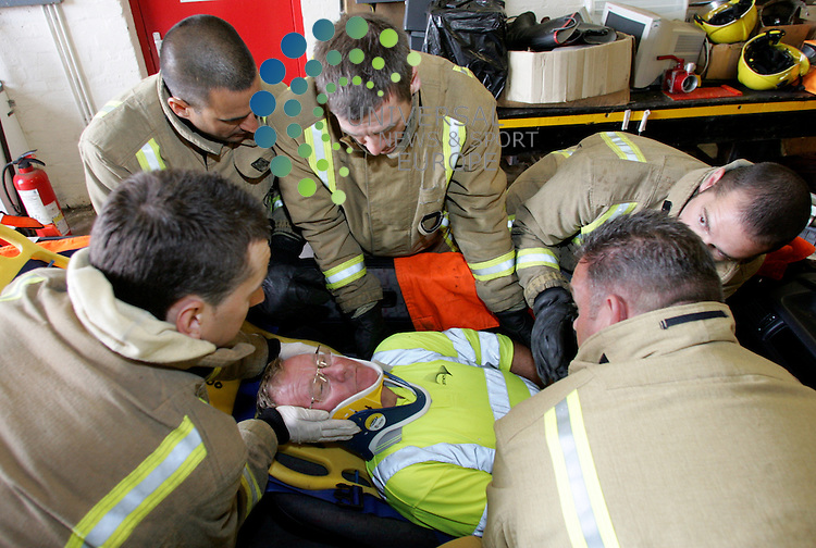 Kilwinning Fire Station giving a demonstration on how to remove a person from a crashed car. Seen here  fitting the back support before lift out from the drivers seat.