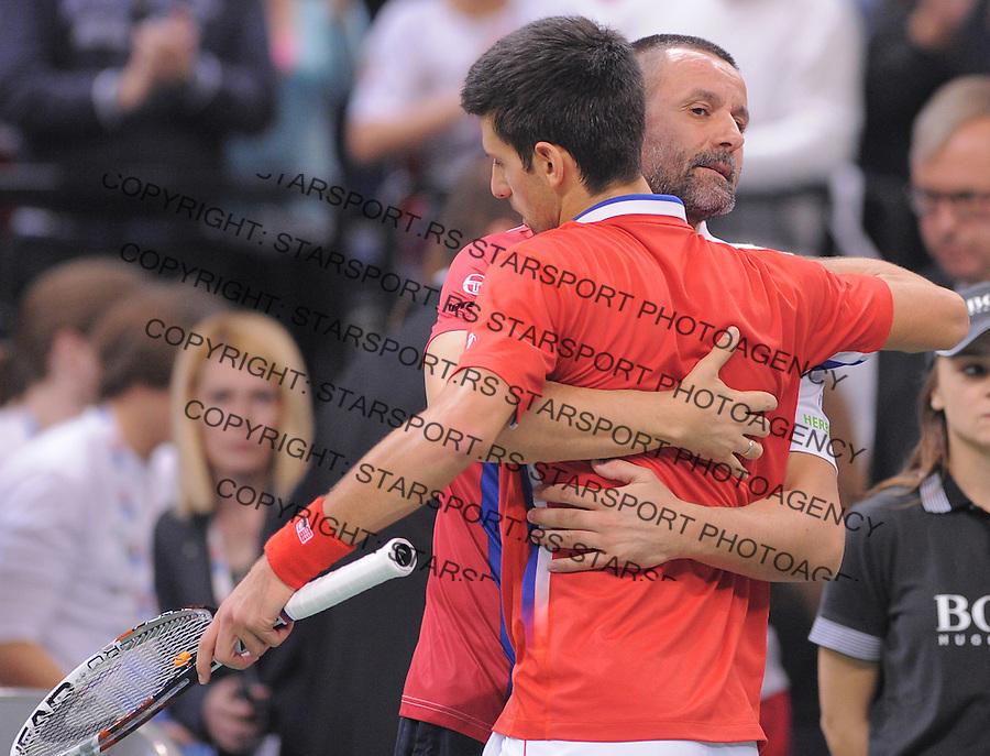 Tennis Tenis<br /> Davis Cup Final 2013<br /> Serbia v Czech Republic<br /> Novak Djokovic v Tomas Berdych<br /> Novak Djokovic and team captain Bogdan Obradovic<br /> Beograd, 17.11.2013.<br /> foto: Srdjan Stevanovic/Starsportphoto &copy;