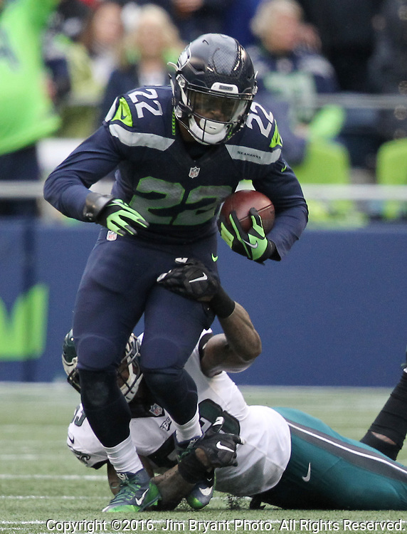 Seattle Seahawks running back C.J. Prosise (22) runs through the attempted tackle of Philadelphia Eagles outside linebacker Nigel Bradham (53) at CenturyLink Field in Seattle, Washington on November 20, 2016.  Seahawks beat the Eagles 26-15.  ©2016. Jim Bryant Photo. All Rights Reserved.