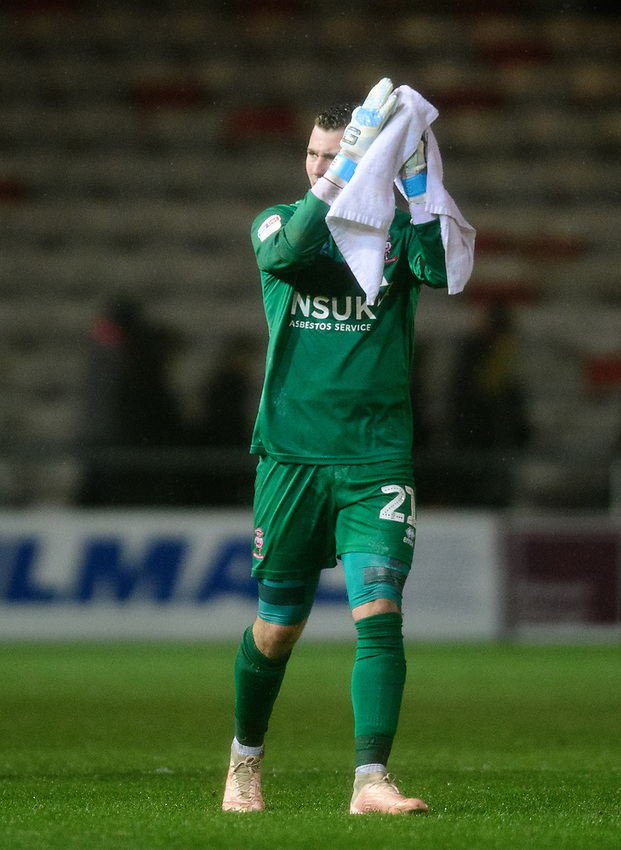 Lincoln City's Grant Smith applauds the fans at the final whistle<br /> <br /> Photographer Chris Vaughan/CameraSport<br /> <br /> The EFL Sky Bet League Two - Saturday 15th December 2018 - Lincoln City v Morecambe - Sincil Bank - Lincoln<br /> <br /> World Copyright © 2018 CameraSport. All rights reserved. 43 Linden Ave. Countesthorpe. Leicester. England. LE8 5PG - Tel: +44 (0) 116 277 4147 - admin@camerasport.com - www.camerasport.com