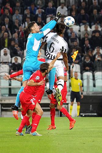30.09.2015. Turin, Italy. Champions League. Juventus versus Sevilla. Sami Khedira is challenged by Sevilla goalkeeper Sergio Rico