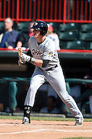 Akron RubberDucks outfielder Jordan Smith (39) looks to bunt during a game against the Erie SeaWolves on May 18, 2014 at Jerry Uht Park in Erie, Pennsylvania.  Akron defeated Erie 2-1.  (Mike Janes/Four Seam Images)