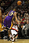 04/08/11--Trailblazers' forward Gerald Wallace  is shoved by Lakers' Andrew Bynum in Portland's 93-86 win over L.A. at the Rose Garden..Photo by Jaime Valdez............................................