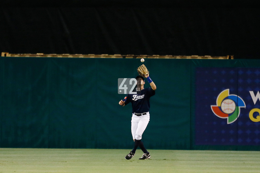 21 September 2012: Emmanuel Garcia catches a fly ball during France vs South Africa tie game 2-2, rain delayed at the end of the 9th inning at 1 AM, during the 2012 World Baseball Classic Qualifier round, in Jupiter, Florida, USA. Game to resume 22 September 2012 at noon.