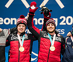 PyeongChang 10/3/2018 - Mac Marcoux and his guide Jack Leitch collect their gold medals in the men's visually impaired downhill during the medal ceremony at the PyeongChang Olympic Plaza during the 2018 Winter Paralympic Games in Pyeongchang, Korea. Photo: Dave Holland/Canadian Paralympic Committee