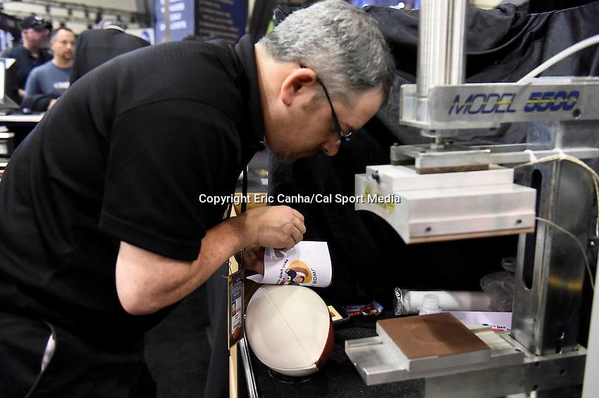 Thursday, February 4, 2016: A vendor mints a custom souvenir at the Super Bowl 50, NFL Experience, in San Francisco, California. Eric Canha/CSM