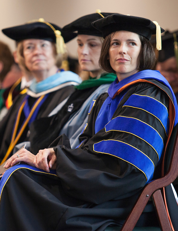 College of Business faculty listen to student speakers at the College of Business Freshman Convocation in Nelson Commons on Saturday, August 22, 2015. Photo by Kaitlin Owens