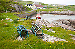 Small fishing boat and lobster pots on the east coast of Barra, Outer Hebrides, Scotland, UK