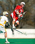 30 April 2011: Stony Brook Seawolves' midfielder Russ Bonanno, a Junior from Seaford, NY, scores against the University of Vermont Catamounts on Moulton Winder Field in Burlington, Vermont. The Catamounts fell to the visiting Seawolves 12-9 to conclude their America East season. Mandatory Credit: Ed Wolfstein Photo