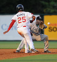 Outfielder Henry Ramos (25) of the Greenville Drive hustles back safely to second base as Delino DeShields Jr. (2) of the Lexington Legends takes the throw in a game on June 6, 2011, at Fluor Field at the West End in Greenville, S.C. Photo by Tom Priddy / Four Seam Images
