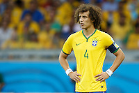 David Luiz of Brazil looks dejected