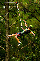 Participants end their flights on the MegaZip line. Riders took flight, zooming through the air over the US National Whitewater Center (USNWC) on the USNWC's zip-lines, part of the facilities high-adventure offerings. The popular outdoor adventure activity lets outdoor enthusiasts be secured into a harness then propelled by gravity along an inclined steel cable. Charlotte, North Carolina's US National Whitewater Center offers multiple zip line courses, which vary in height and distance traveled, as well as one of the largest outdoor climbing facilities in the world. The USNWC is a non-profit outdoor recreation facility open to the public for whitewater rafting, kayaking, canoeing, rappelling, zip lining, mountain biking, hiking, climbing and more. The center opened to the public in 2006.