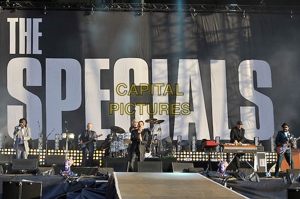 The Specials .performing at BT London Live Closing Ceremony Celebration Concert, Hyde Park London, England. .12th August 2012.on stage in concert live gig performance full length jeans denim black jacket singing .CAP/MAR.© Martin Harris/Capital Pictures.