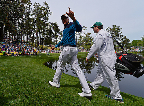 06.04.2016. Augusta, GA, USA. Ian Poulter, left, and his caddie Terry Mundy walk to the ninth green during the Par 3 contest on Wednesday, April 6, 2016, at Augusta National Golf Club in Augusta, Ga