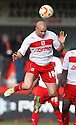 Gavin Mahon of Stevenage heads clear. Stevenage v Sheffield United - npower League 1 -  Lamex Stadium, Stevenage - 16th March, 2013. © Kevin Coleman 2013.. . . .