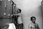 Changing rooms each man has his own locker. South Kirkby Colliery, Yorkshire England. 1979. Opened in 1881, closed in 1988 and later demolished. Photographs show Dave Bennett ( Official )and Ernie Moore (Face Man)