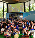 June 15, 2014, Tokyo, Japan - Japanese soccer fans jubilate when Keisuke Honda scores the first goal as they watch Japans first world cup game against Ivory Coast in public viewing at Tokyos Marunouchi business district on Sunday, June 15, 2014. Japan led Ivory Coast 1-0 in the first half of her inaugural match in the preliminary round of the 2014 FIFA World Cup in Recife, Brazil. The west African came back in the second half of the game with a 2-1 stunning victory. (Photo by Natsuki Sakai/AFLO) AYF -mis-