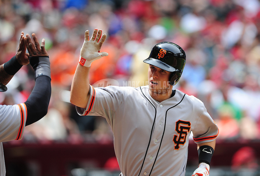 Apr. 8, 2012; Phoenix, AZ, USA; San Francisco Giants catcher Buster Posey is congratulated by teammates after hitting a two run home run in the third inning against the Arizona Diamondbacks at Chase Field. Mandatory Credit: Mark J. Rebilas-