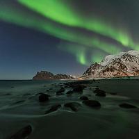 Northern Lights - Aurora Borealis fill sky over Uttakleiv beach, Vestvågøy, Lofoten Islands, Norway