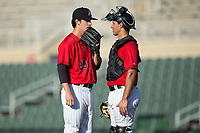 Kannapolis Intimidators catcher Seby Zavala (21) has a chat with relief pitcher Danny Dopico (29) during the game against the Hagerstown Suns at Kannapolis Intimidators Stadium on June 14, 2017 in Kannapolis, North Carolina.  The Intimidators defeated the Suns 4-1 in game one of a double-header.  (Brian Westerholt/Four Seam Images)