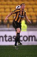 Phoenix striker Chris Greenacre heads the ball during the A-League football match between Wellington Phoenix and Perth Glory at Westpac Stadium, Wellington, New Zealand on Sunday, 16 August 2009. Photo: Dave Lintott / lintottphoto.co.nz