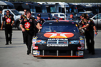 Sept. 26, 2008; Kansas City, KS, USA; The car of Nascar Sprint Cup Series driver Juan Pablo Montoya is pushed to the garage after qualifying for the Camping World RV 400 at Kansas Speedway. Mandatory Credit: Mark J. Rebilas-