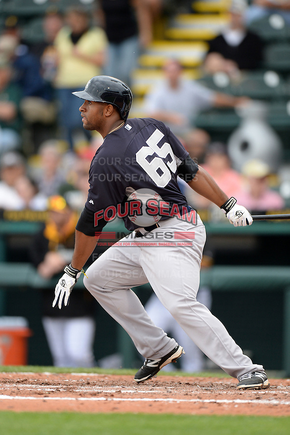 Outfielder Zoilo Almonte (65) of the New York Yankees during a spring training game against the Pittsburgh Pirates on February 26, 2014 at McKechnie Field in Bradenton, Florida.  Pittsburgh defeated New York 6-5.  (Mike Janes/Four Seam Images)