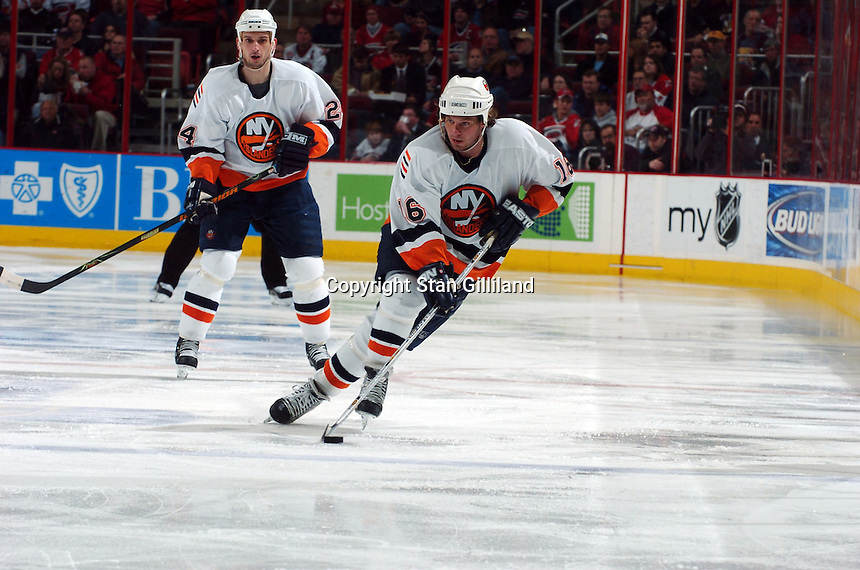 New York Islanders' Mike York (16) brings up the puck as teammate Radek Martinek (24) of the Czech Republic follows during their game against the Carolina Hurricanes Thursday, Jan. 19, 2006 in Raleigh, NC. Carolina won 4-3.