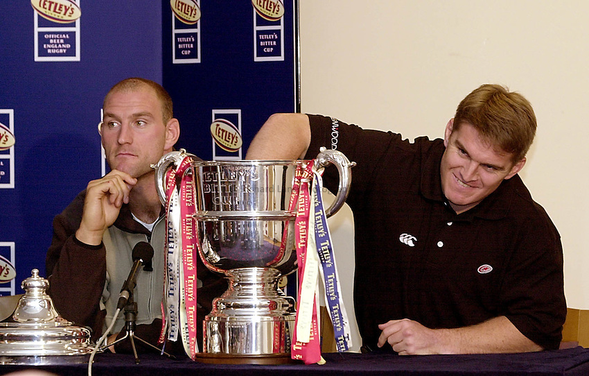 Photo Ken Brown.10.10.2000 Tetley Cup 3/4/5th round draws.Tim Horan reaches in to the cup during the fifth round draw as Lawrence Dallaglio looks on