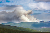 Aircraft attempt to suppress the Hastings wildland forest fire near Murphy Dome north of Fairbanks, Alaska.