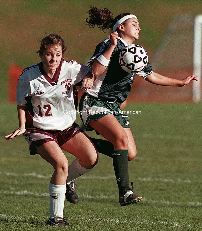 NAUGATUCK, CT.10/23/98-1023MA02.TIF-Laureen Decerbo, left of Naugatuck and Nicole Porzio of Holy Cross battle for the ball during first half soccer action at Naugatuck High School Friday afternoon. MICHAEL ASARO staff photo for sports