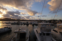 Caleta de Fuste at dusk, with fishing and pleasure boats in the harbour, Fuerteventura, Canary Islands, Spain