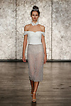 Model walks runway in an off-the-shoulder top with fully beaded pencil skirt, from Inbal Dror Fall 2018 bridal collection on October 5, 2017; during New York Bridal Fashion Week.
